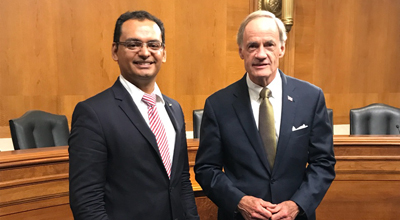 Senator Tom Carper, Dem-Delaware, and Rogelio Martinez, CEO Fast Cloud